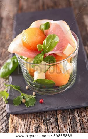 salad with melon,prosciutto and cucumber