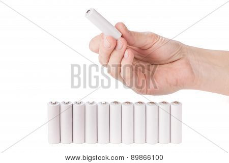 Female Hand Holding A Aa Battery