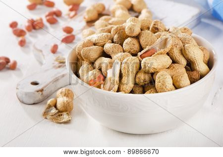 Peanuts In Shells In A    White Bowl.