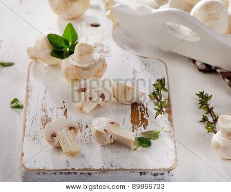 Fresh Whole White Button Mushrooms  On  Wooden Board.