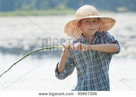 Angler Boy Is Throwing Bait Of Handmade Fishing Rod