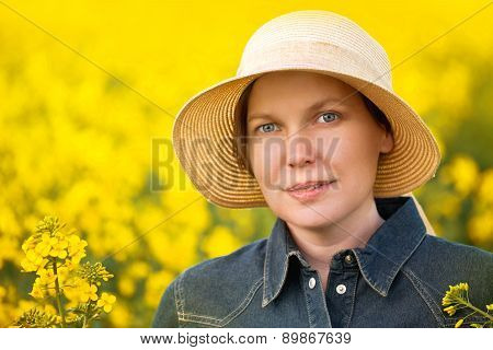 Female Farmer In Oilseed Rapeseed Cultivated Agricultural Field