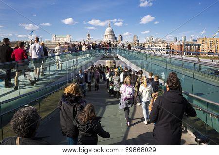 People Walking Across A Footbridge Millennium Bridge