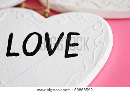 Love Wooden White Heart On Pink Background, Horizontal Composition