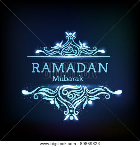 Elegant grreting or invitation card with floral design decorated stylish text Ramadan Mubarak on shiny blue background.