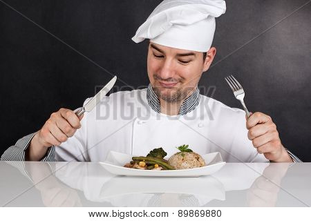 Chef Eating His Prepared Food With Cutlery