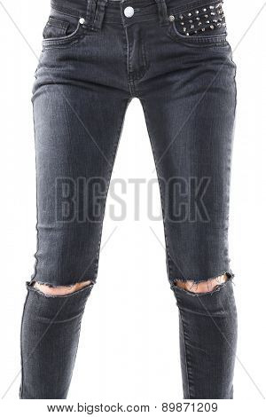 Girlish legs in torn jeans isolated on white