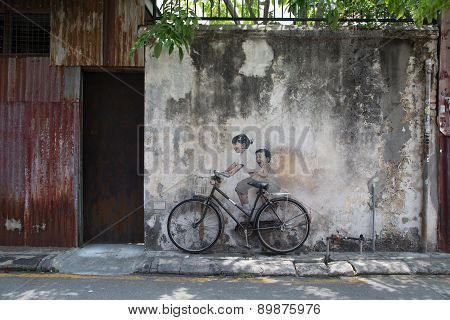 George Town,penang ,malaysia- Circa March 26, 2015: Public Street Art Name Children On A Bicycle Pai