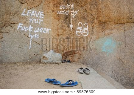 KAMALAPURAM, INDIA - 03 FEBRUARY 2015: Sign painted on wall in front of temple -
