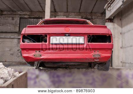Back side of the crashed red car