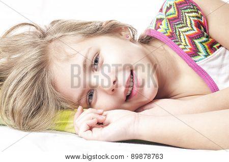 Sweet Happy Little Girl In Bed