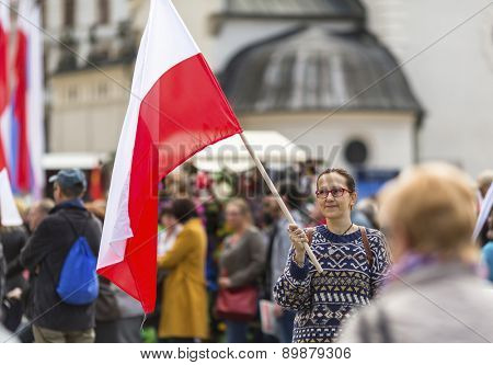 Young woman with the Polish flag in the street.