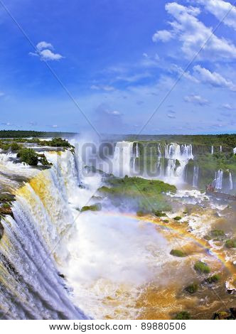 Boiling water foam, crashing and falling jets, a fine mist over the water. The most high-water waterfall in the world - Iguazu. The Brazilian side