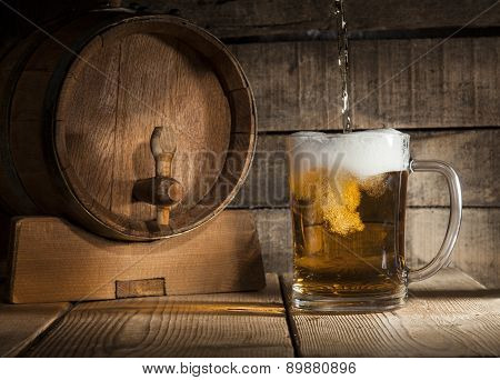 Beer Barrel With Beer Mug On Wooden Background