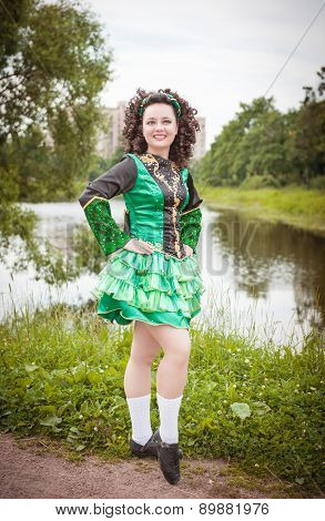 Young Beautiful Girl In Irish Dance Dress And Wig Posing