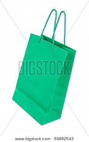 Green Shopping Bag Falling Through The Air On An Isolated White Background