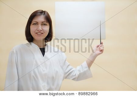 Optometrist woman points to the table for testing visual acuity