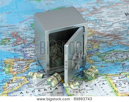 Money On The World. Steel Safe With Money On The World Map. International Banking Concept.