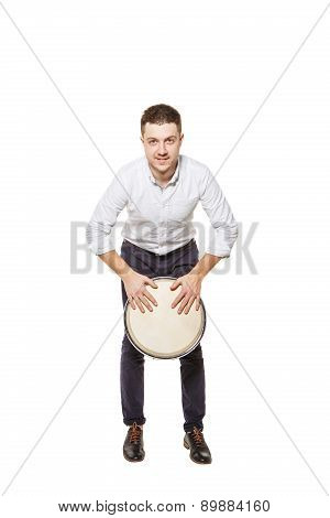Man Playing The Djembe Standing