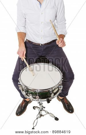 Young Man Playing On A Drum