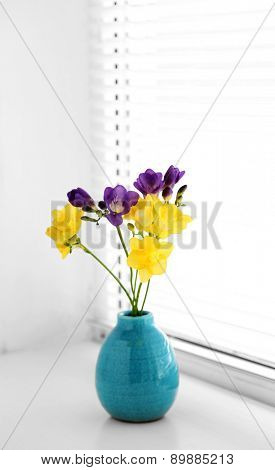 Colorful beautiful freesias in light interior