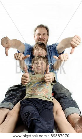 Happy father playing with his son and daughter on a white isolated