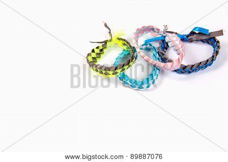 Fashion bracelets braided ribbons on white izolirvanny