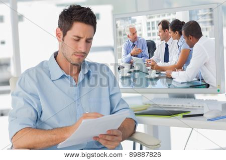 Group of business people brainstorming together against photo editor writing on documents