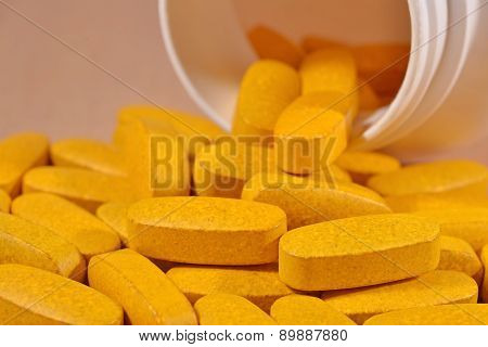 Yellow Pills Spill Out From Bottle