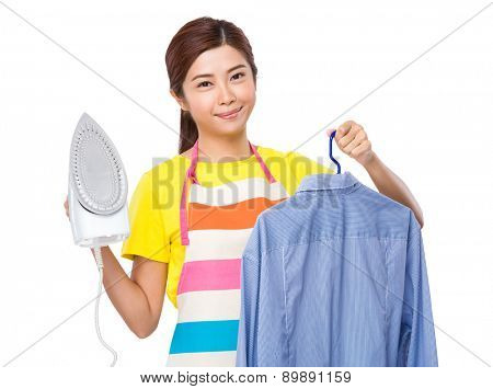 Housewife use steam iron and suit jacket