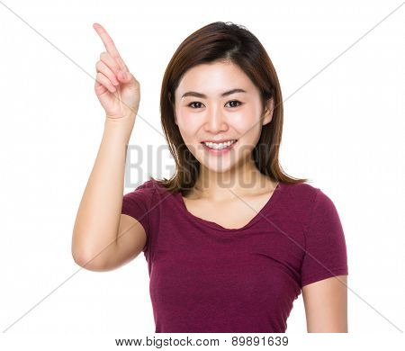 Young woman with finger point up