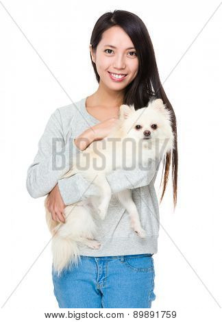 Asian woman with her pomeranian dog