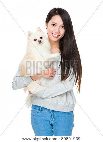Woman with pomeranian dog