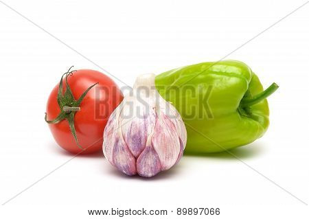 Garlic, Tomato And Sweet Pepper On White Background Close Up