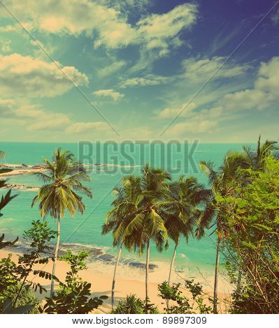 beautiful tropical beach landscape with turquoise sea and clouds - vintage retro style