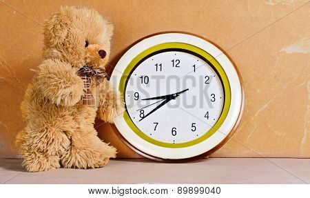 Toy - a little bear and clock