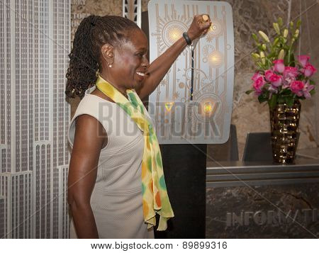 NEW YORK - MAY 5, 2015: New York First Lady Chirlane McCray flips the switch to light the Empire State Building green to raise awareness for mental health needs and services in NYC.