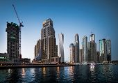 picture of marina  - Panoramic view with modern skyscrapers and water channel of Dubai Marina in evening - JPG
