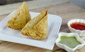 stock photo of samosa  - samosa is a popular indian snack - JPG