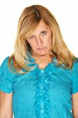 foto of sulky  - Woman in blue with sorry facial expression - JPG