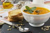 stock photo of ginger bread  - Soup of carrots with ginger on old table background - JPG