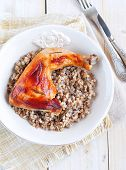 foto of buckwheat  - Delicious baked chicken with boiled buckwheat and rosemary sauce - JPG