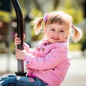 stock photo of playground  - Cute little girl on outdoor playground equipment - JPG