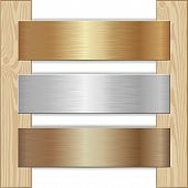 stock photo of plaque  - golden silver and bronze plaques nailed to wooden planks - JPG