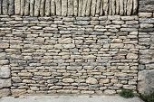 stock photo of old stone fence  - Old stone wall texture - JPG