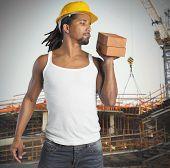 stock photo of mason  - Sexy man mason builds buildings with bricks - JPG