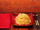 stock photo of carbonara  - spaghetti carbonara served on a wooden table top - JPG