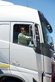 foto of big-rig  - Big truck driver in cabin - JPG