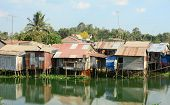 image of early morning  - Colorful squatter shacks and houses in a Slum Urban Area in early morning Ho Chi Minh City Vietnam - JPG