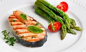 image of white asparagus  - Salmon with asparagus and herbs on white plate - JPG